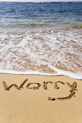 """Waves washing away the word """"worry"""""""